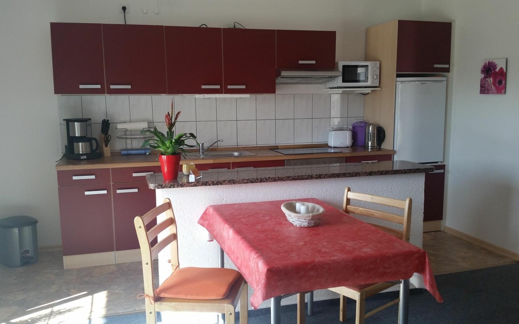 Ansicht FeWo mit offenem Küchenbereich, Foto: MuT Guben